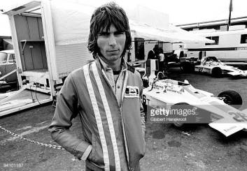 ZANDVOORT, NETHERLANDS: Cozy Powell posed in front of Graham Hill's racing car in Zandvoort, Holland in 1974 (Photo by Gijsbert Hanekroot/Redferns)
